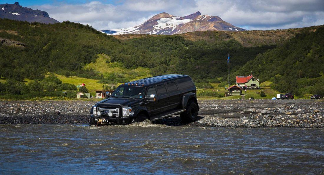 A super Jeep crossing a river