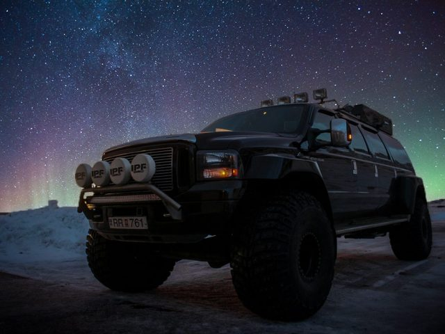 A Ford Excursion Super Jeep under the Northern Lights
