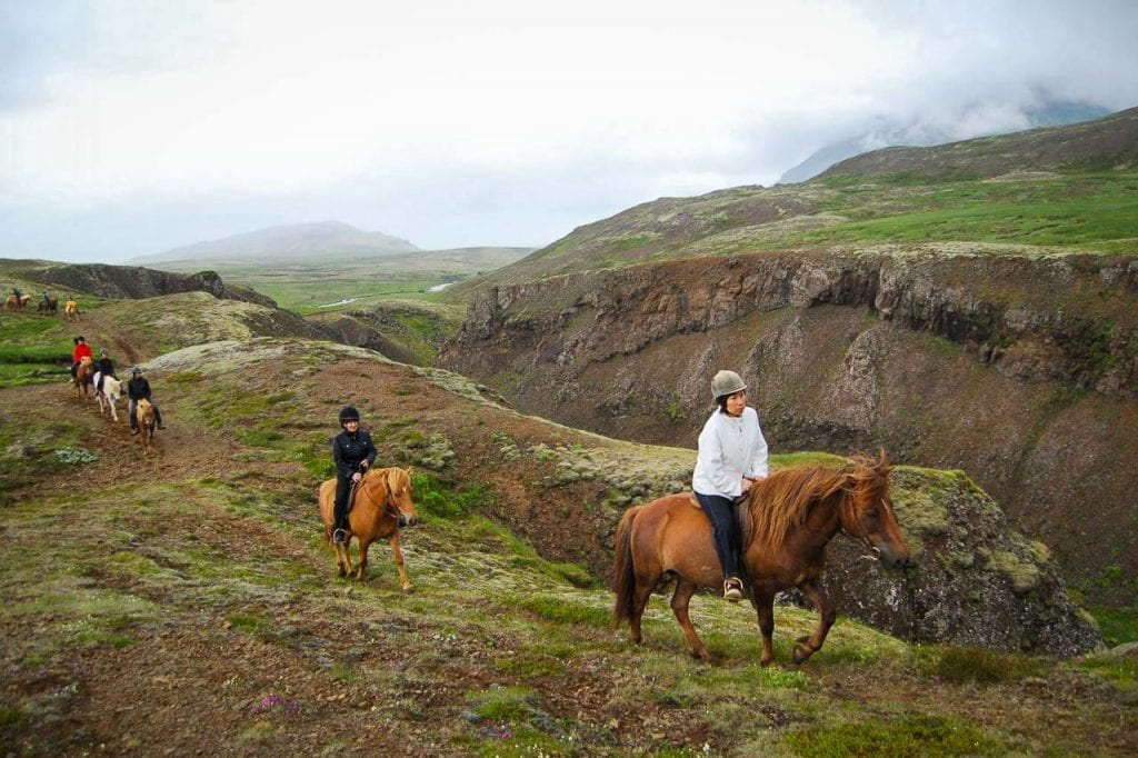 Horse riding on lava fields