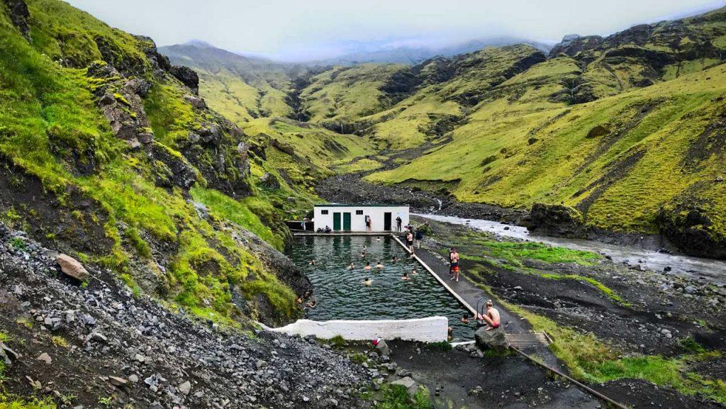 Bathing in Seljavallalaug pool