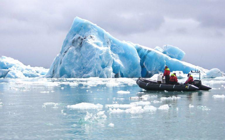 Exploring an iceberg - Zodiac boat tour
