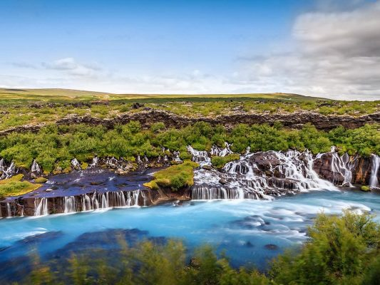 Visiting Hraunfossar waterfall on a Private Silver Circle tour